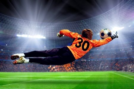 Football goalman on the stadium field © Depositphotos