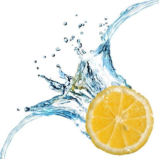 Fresh lemon dropped into water with splash isolated on white
