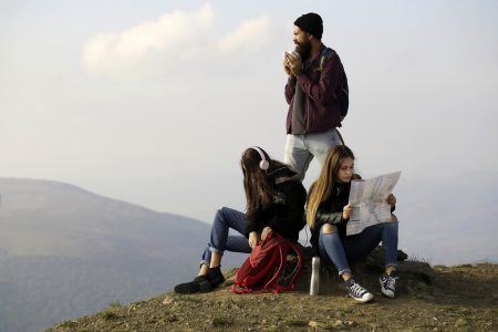 Young travelers with map