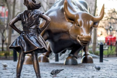 «The Fearless Girl» statue facing Charging Bull in Lower Manhatt