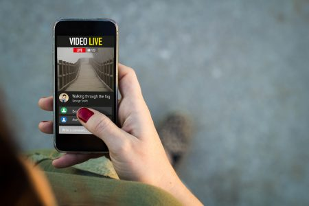 Woman walking and watching a live video