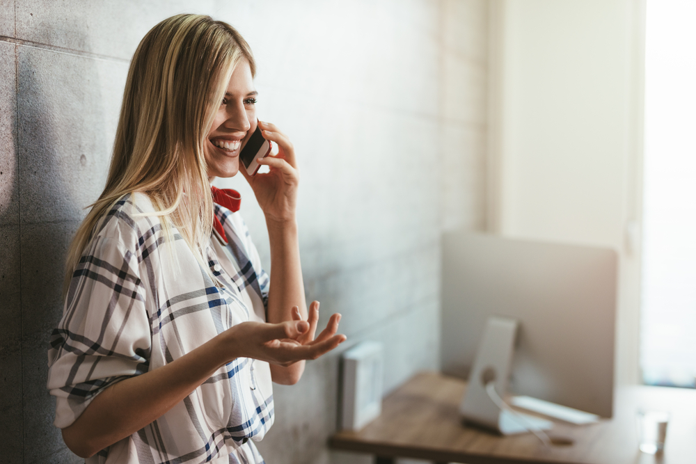 stock photo girl with a cellphone at her office