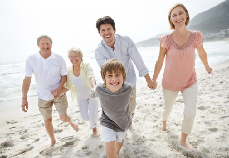 Happy family walking on the beach   Outdoor