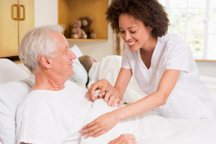 Nurse Helping Senior Man © Depositphotos