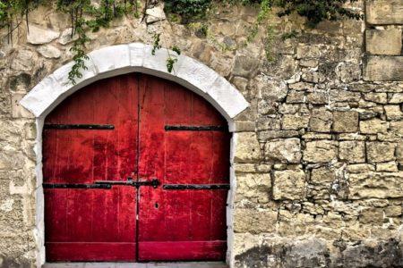 Medieval Red Door © Depositphotos