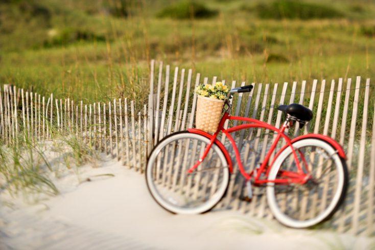 Bicycle at beach. © Depositphotos