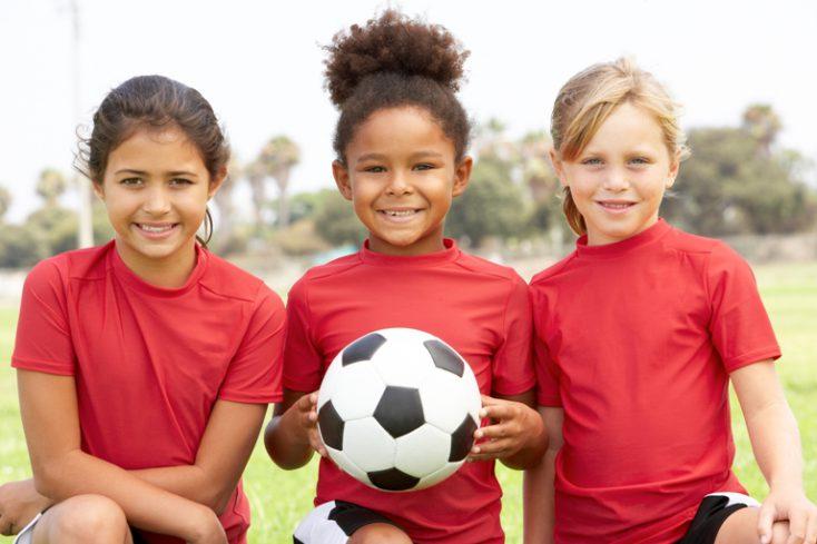 Young Girl In Football Team © Depositphotos