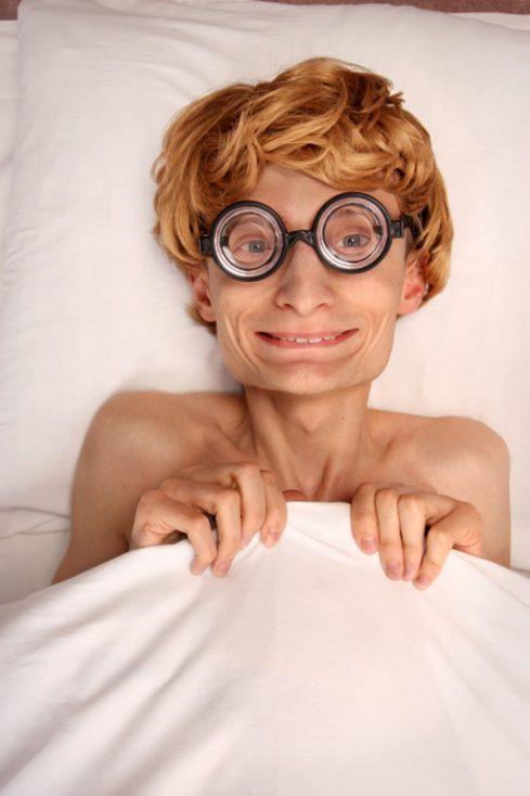 Funny guy under blanket © Depositphotos