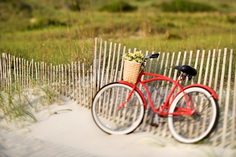 Bicycle at beach. © Depositphotos