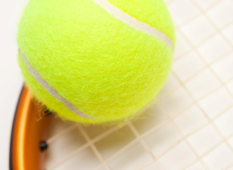 Abstract Tennis Ball, Racquet and Nylon Strings. © Depositphotos