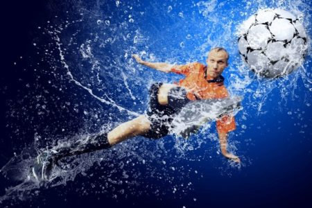 Water drops around football player under water on blue backgroun © Depositphotos