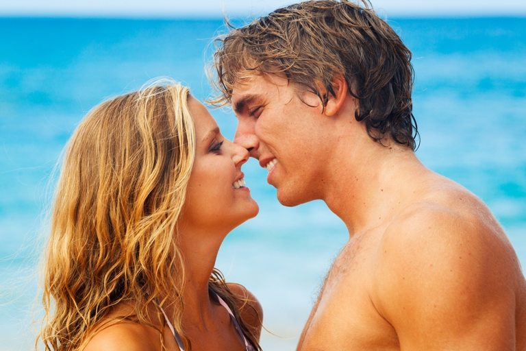 Young Couple Kissing on Tropical Beach | Stock Photo © Depositphotos
