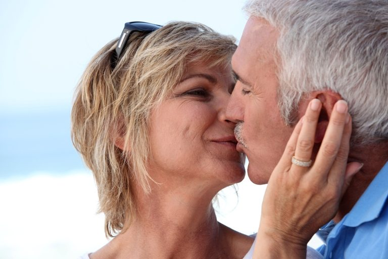 Couple kissing   Stock Photo © Depositphotos