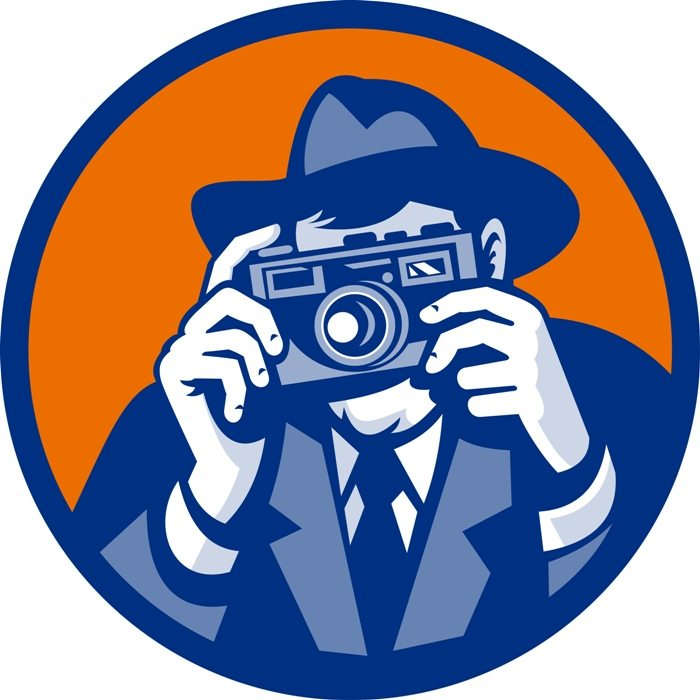 Photographer with fedora hat aiming retro slr camera | Stock Photo © Depositphotos