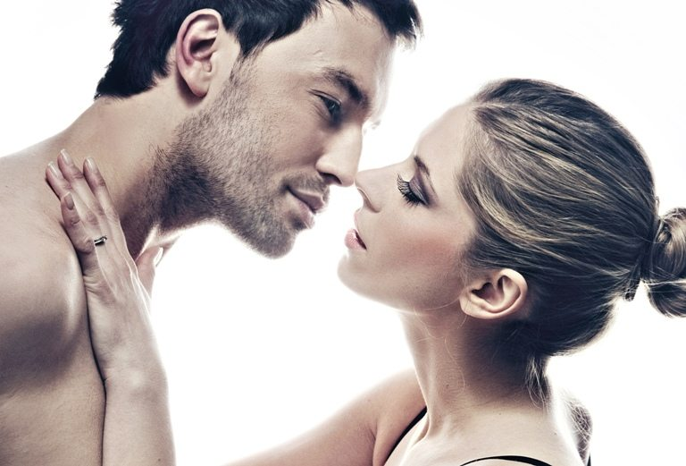 Portrait of handsome couple gently kissing   Stock Photo ©