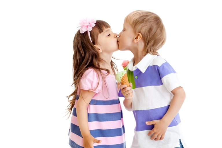 Girl and boy are kissing with ice cream in hands isolated | Stock Photo © Depositphotos