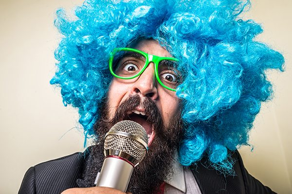 Сrazy funny bearded man with blue wig