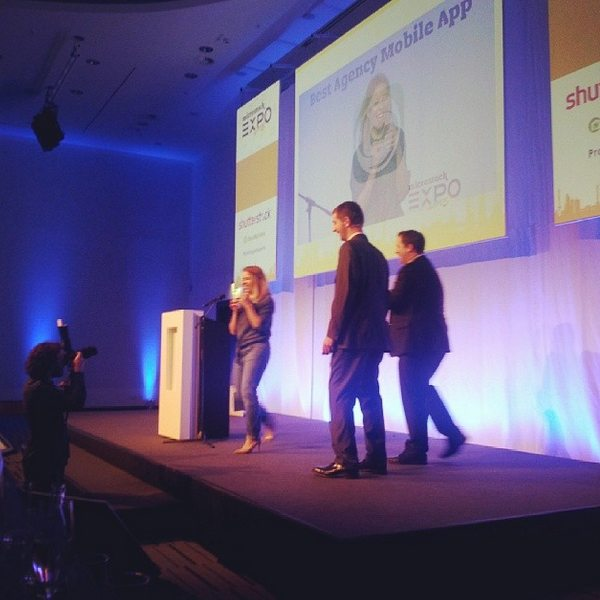 Elena Flanagan Eister on stage receiving the Best agency Mobile app Awards for Clashot