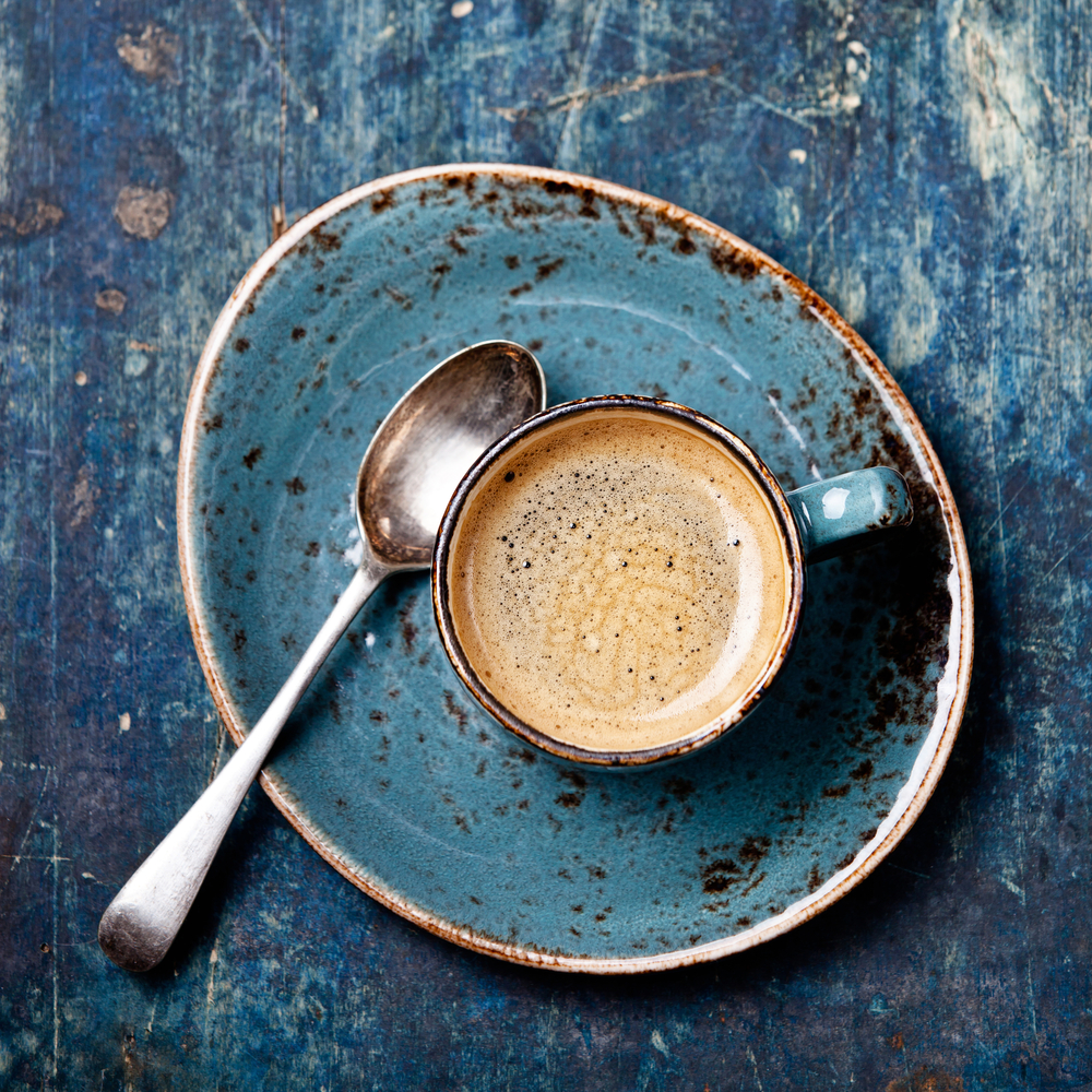 Espresso cup on blue background