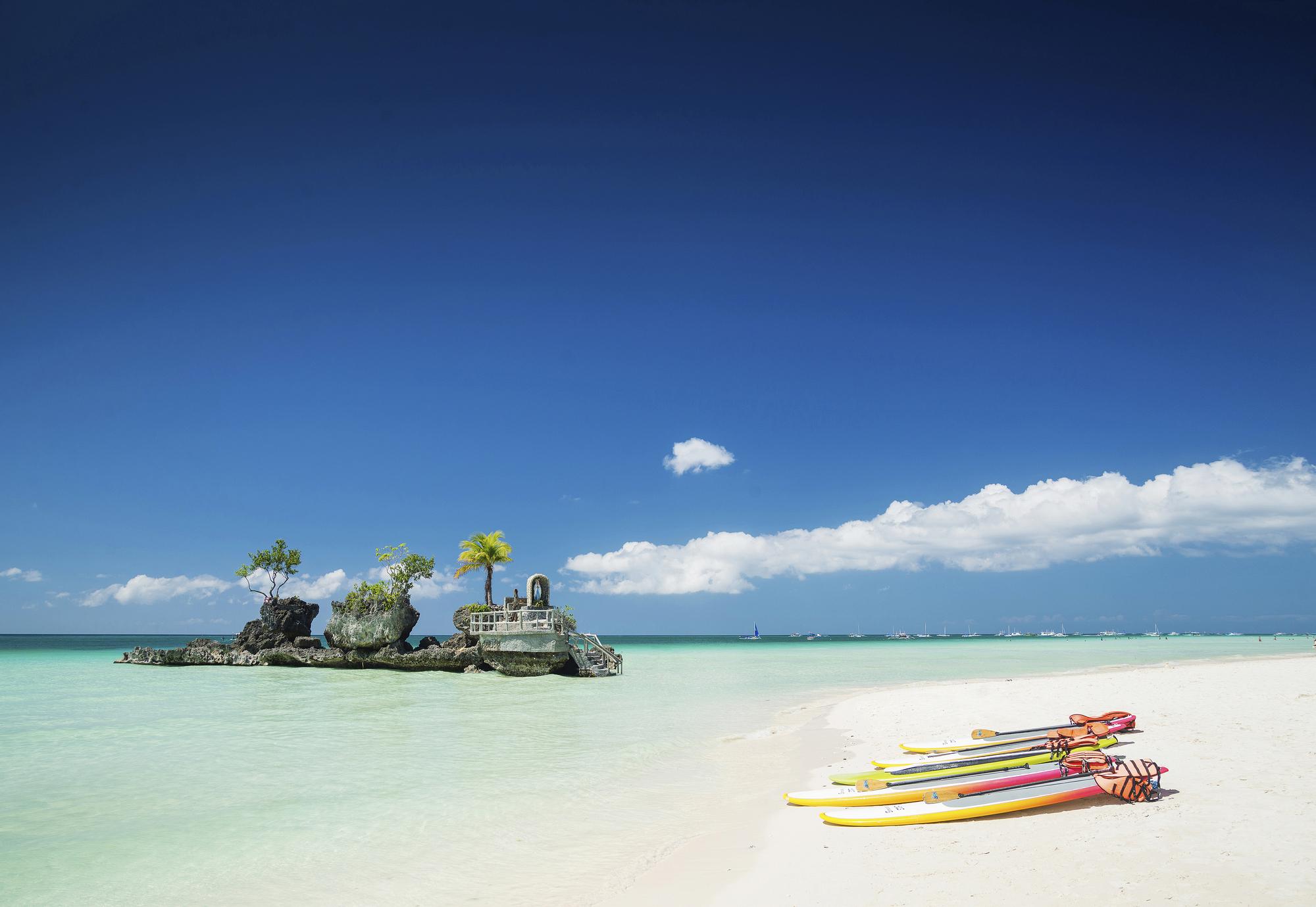 tropical beach christian shrine stock photo