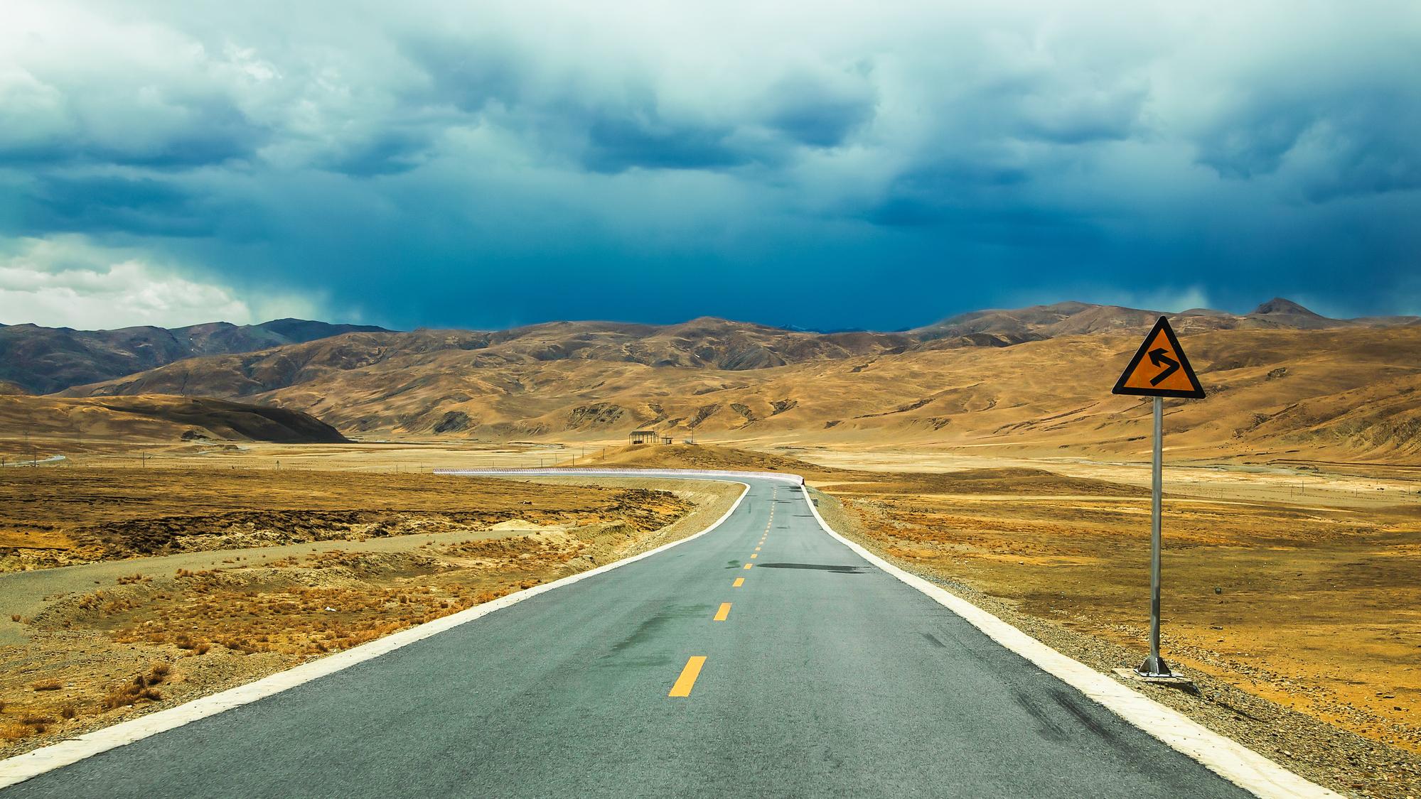 stock photo Long empty asphalt road in desert