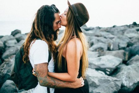 photo of a couple by the beach