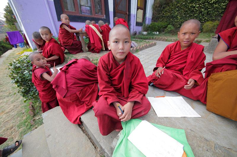Yury Birukov photography monk children studying