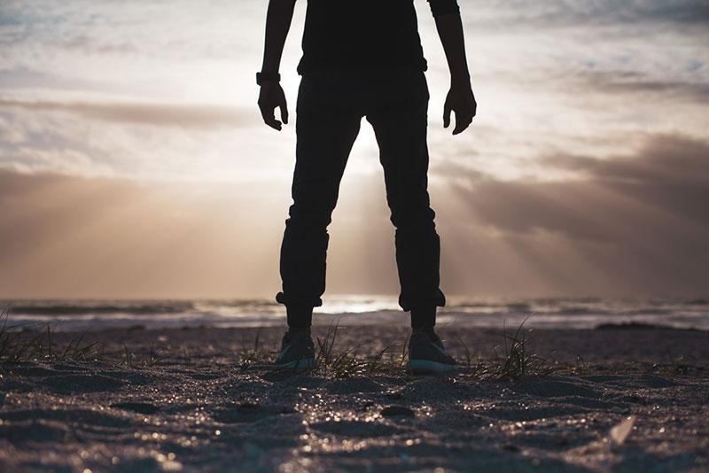 Justin Govender man standing on the beach