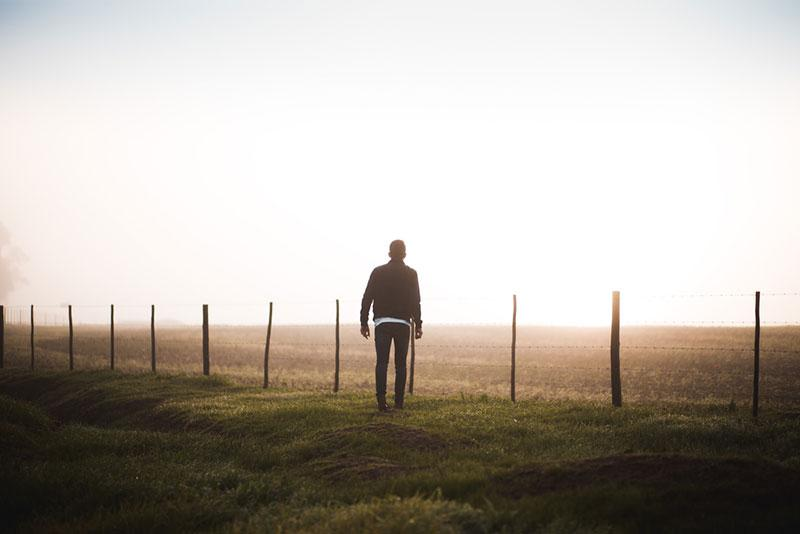Justin Govender photography man walking into foggy field
