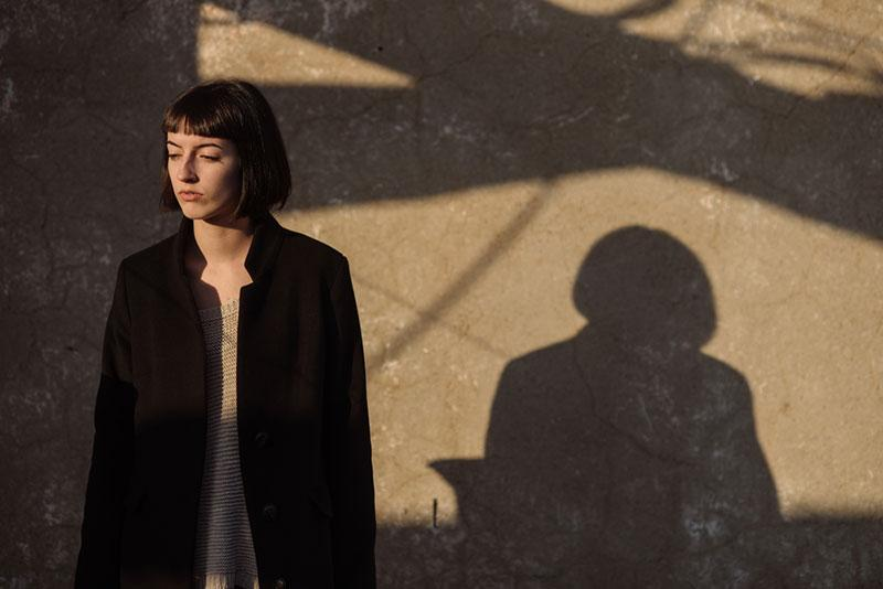Mihajlo Ckovric stock photography of woman and her shadow on the wall