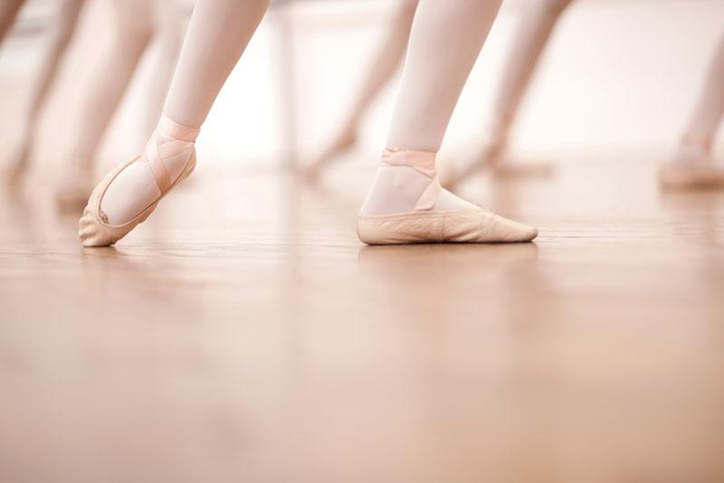 Detail of ballerinas legs in dance class, low section