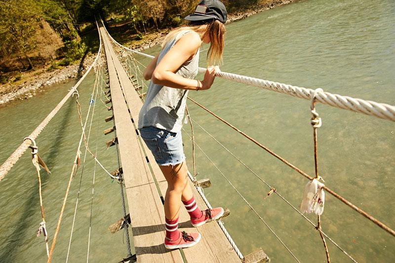 Evgeny Lobanov photography   girl on a rope bridge