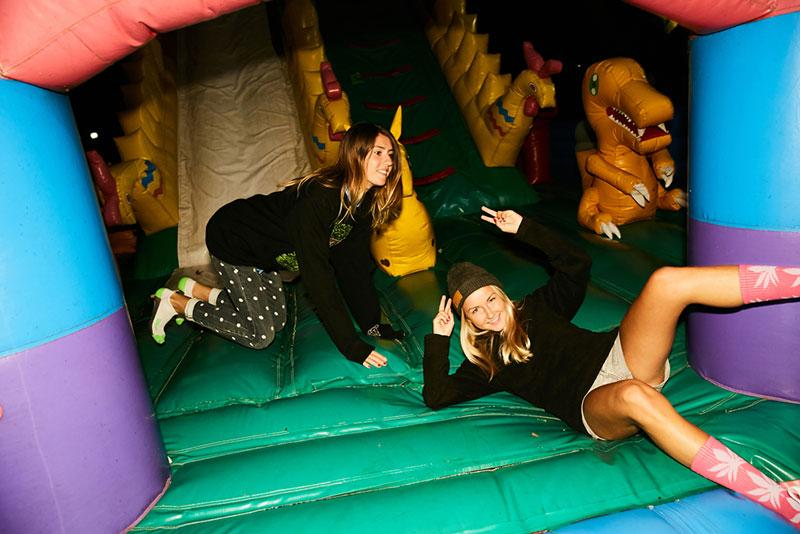 Evgeny Lobanov photography - teenagers in an inflatable castle