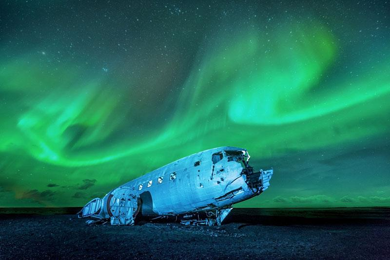 Northern lights over plane wreckage, Iceland