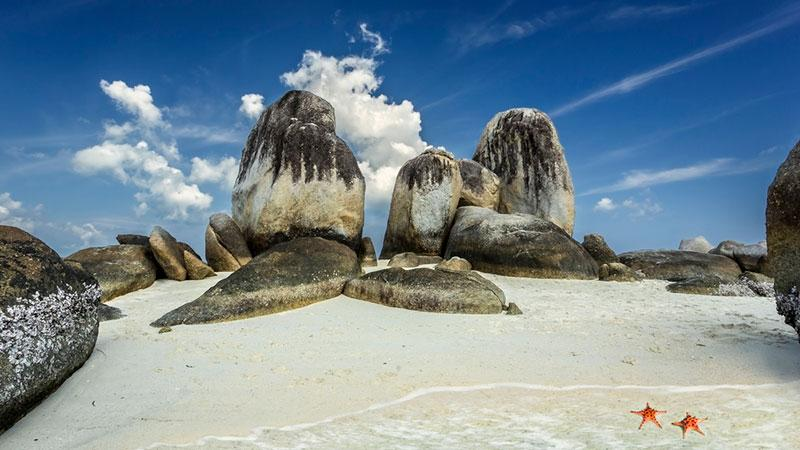 Granite rocks and starfish on the beach, Belitung island, Indonesia