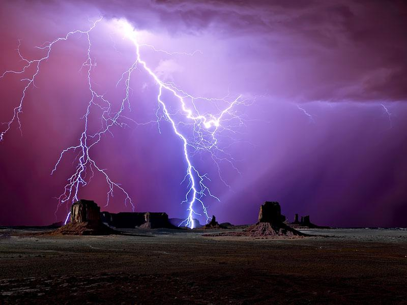 Scenic view of majestic lightning over Monument Valley, Arizona, America, USA