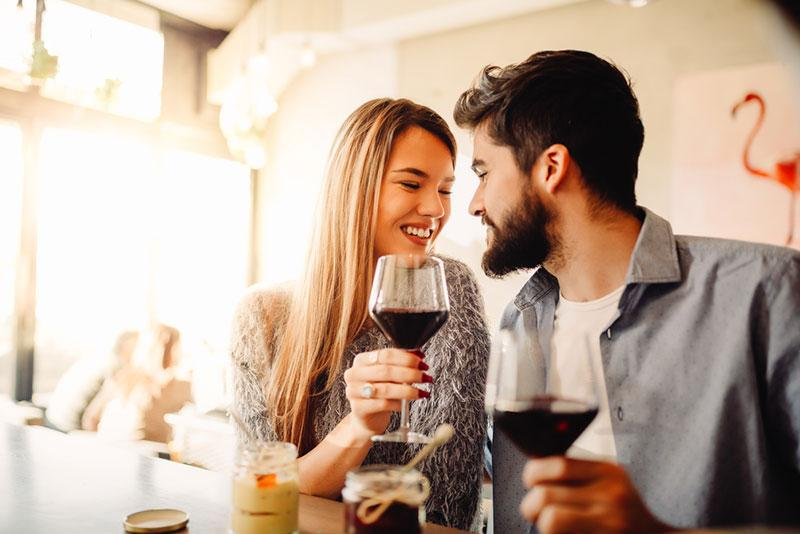 Nebojsa Tatomirov stock photography   Young couple celebrating their anniversary in cafe with glasses of wine