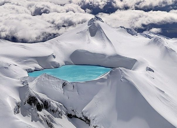 Emerald Lake is located in Tongariro National Park in New Zealand. It's located in the crater of an extinct volcano!