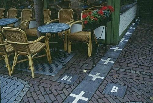 This is the border between Belguim and the Netherlands. This picture is taken in Belguim outside a cafe located in the Netherlands