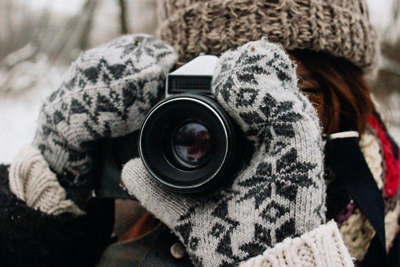 Stylish gorgeous girl with photocamera