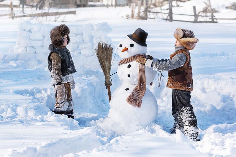 https://depositphotos.com/221347934/stock-photo-two-little-boys-sculpt-snowman.html