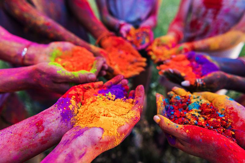 colorful powder in hands during holi festival