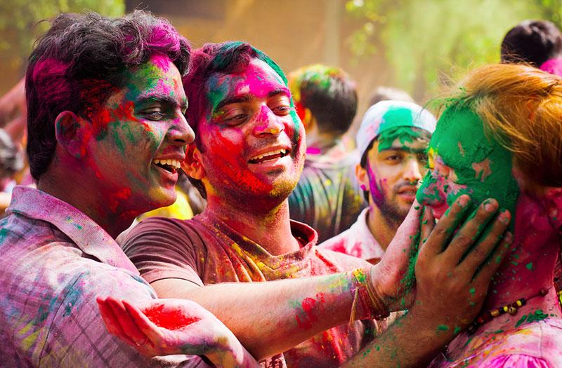 People are smearing powders at holi festival of colors