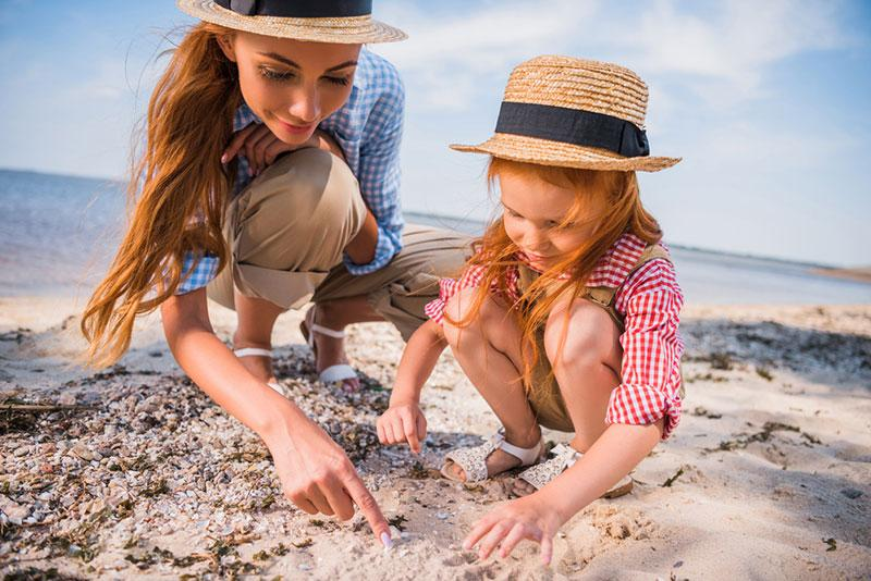 https://depositphotos.com/163316736/stock photo mother and daughter collecting seashells.html