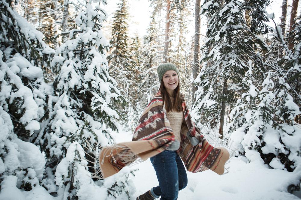 Beautiful woman among snowy tree