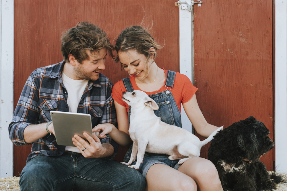 Happy couple living with dogs