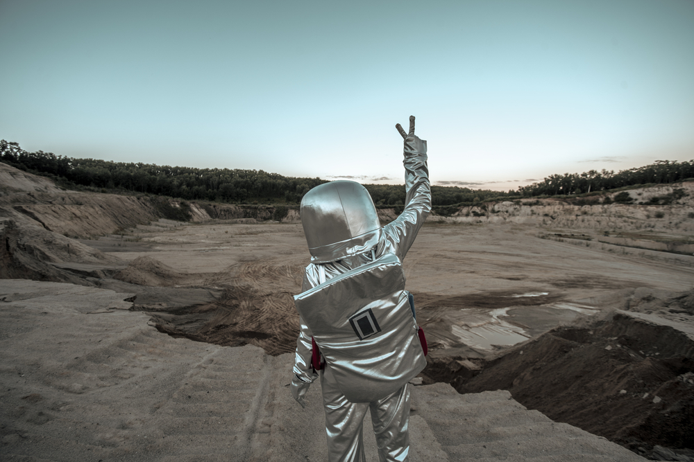 Spaceman making peace sign