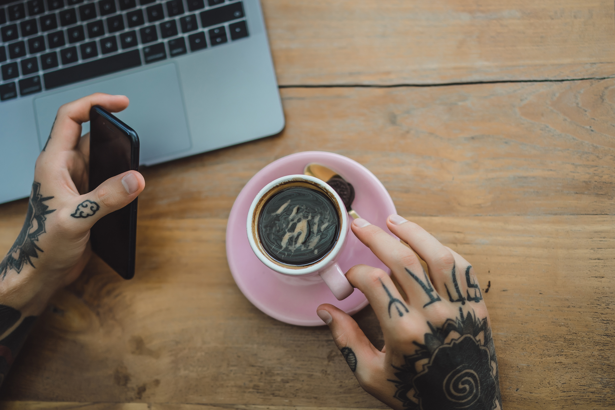 image of tattooed hands, coffee and laptop