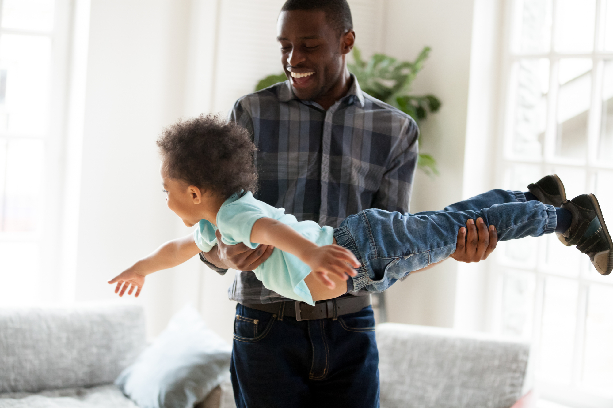father playing with child stock image