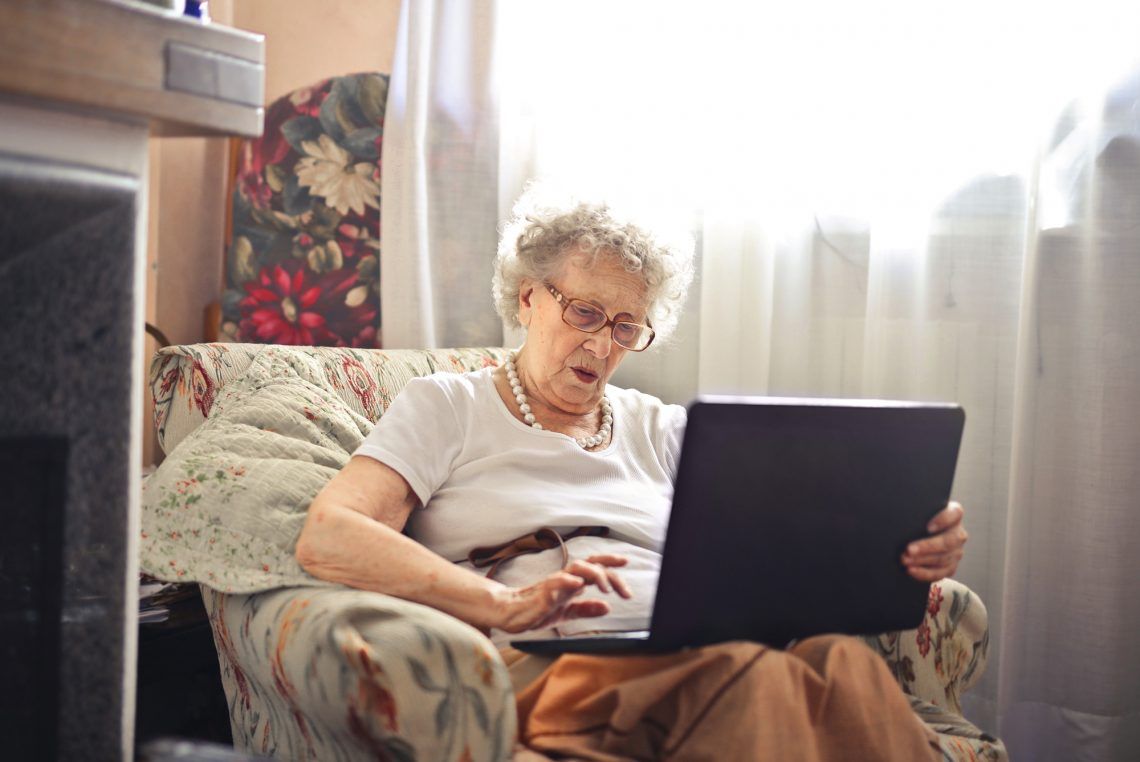 old woman with a laptop stock image